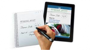 an image of an individual using a Smart Pen in conjunction with an iPad.